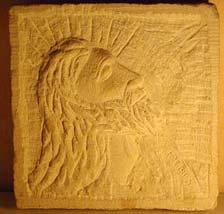Le profil du Christ en bas-relief